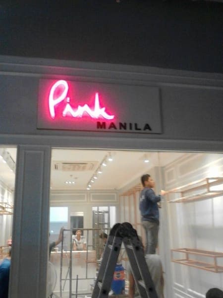 pink manila   store signage