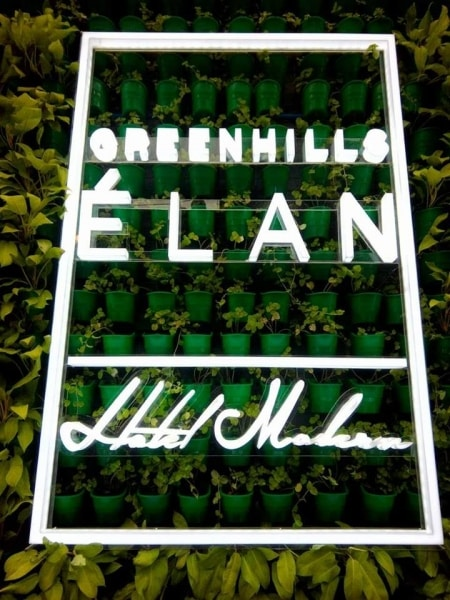 elan greenwall with signage