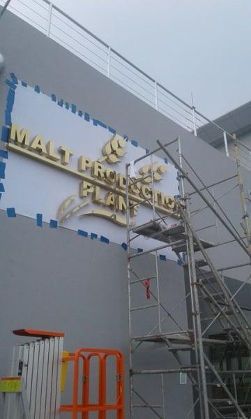 brass building sign