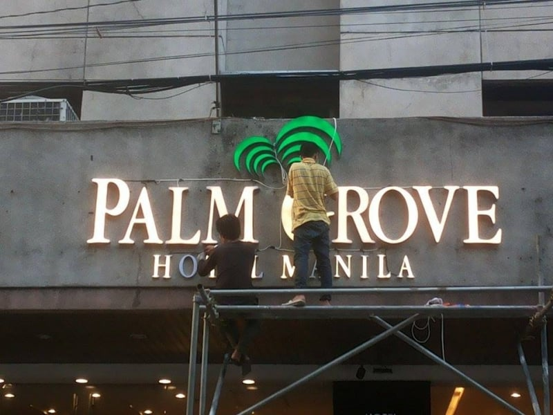 palm grove building sign