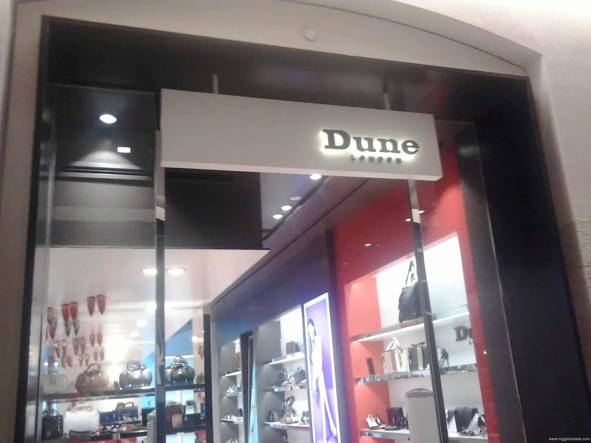 Dunes store signage|stainless signage